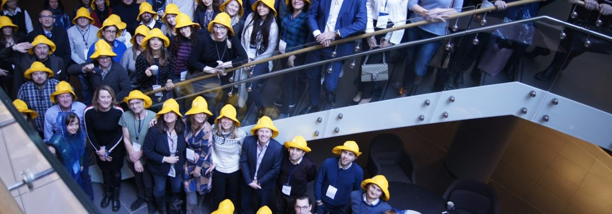 Indoors is one of few places it doesn't rain in Bergen. ENEX members with TV2 rain hats